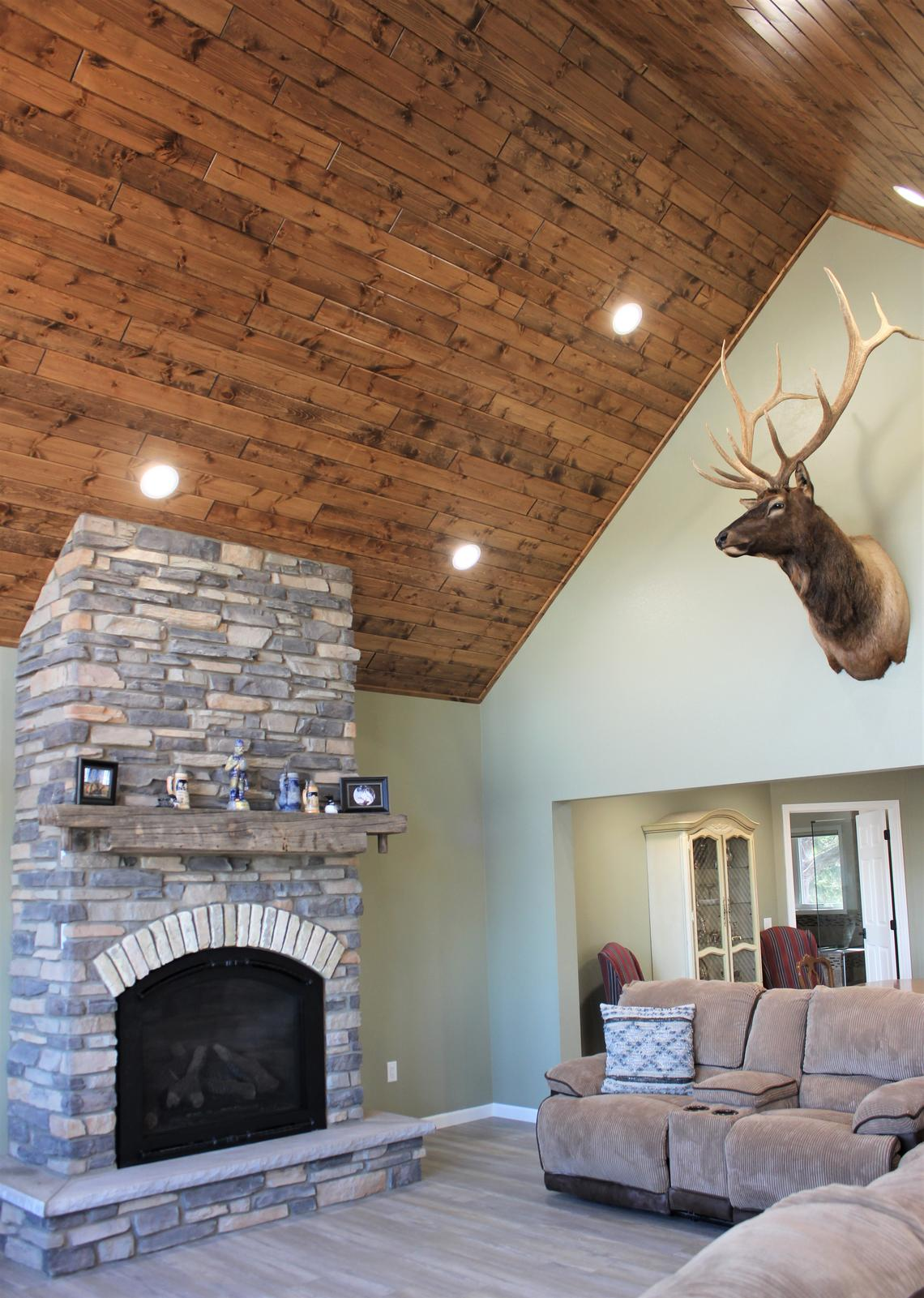 A new great room on the main floor of the Hammans home features vaulted ceilings and tall windows for view of Paul Lake. Incorporated into the fireplace are bricks from Mary Kay's old high school in Milwaukee, Wisc. (Submitted Photo)