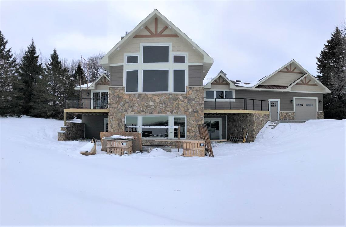 A lakeside view of the home this past winter, AFTER most of the exterior remodeling had been finished. (Submitted Photo)